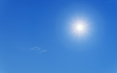 A blue sky with sun